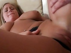 Honey is stimulating males manhood with blowjob