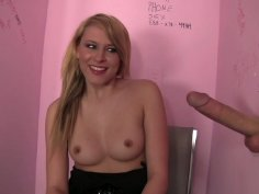Kinky blonde whore Katie Summers sucks the dick sticking out of the hole in a wall