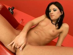 Sizzling Suzy Black wankers on a red couch performing her first solo act