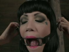 Talkative BDSM fan Asphyxia Noir gets a gag into her mouth