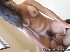 Busty brunette with hairy pussy Selena Steele rides a cock hard